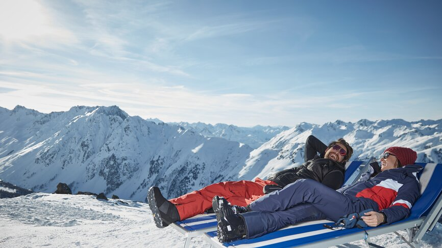 Skiers relax in the ski area of Ischgl