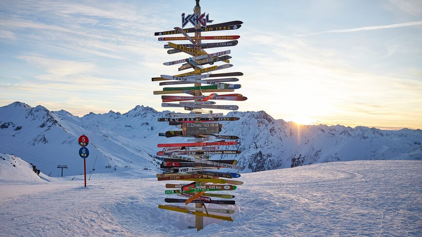 Signpost in the ski area of Ischgl at sunset
